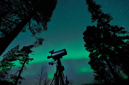 Pole Star, Big Dipper, falling star and aurora borealis same time on the sky.