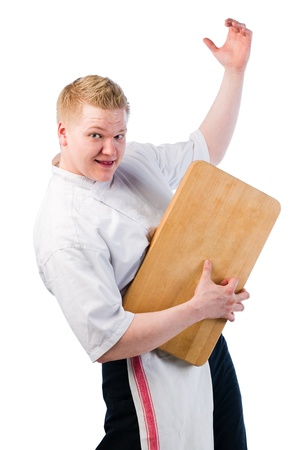 air guitar: Young cook playing air guitar with a chopping board