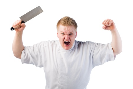 Young cook is really angry and he swinging knife in the air photo
