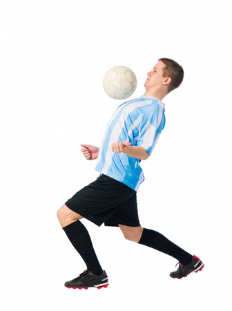 Soccer player trap a ball with his chest