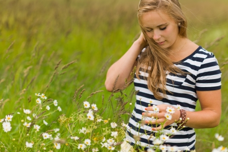 meadowland: Young beauty girl on the meadow with very narrow depth of field and focus on the face Stock Photo