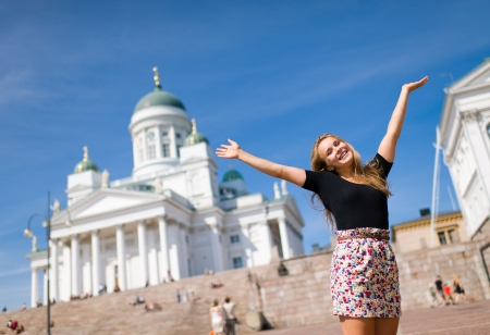 Beautiful girl of city Helsinki smiling, Helsinki Cathedral on the background and its a sunny summer day Stock Photo