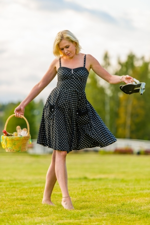 Woman goes to the picnic, barefoot, she takes little dance steps photo