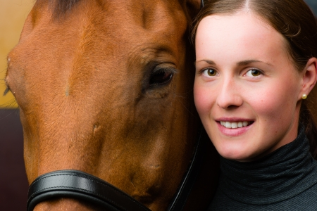 half blooded: Woman and horse together, woman looks toward camera, horizon format