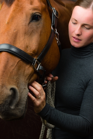 headcollar: Woman and horse together, woman looks toward horse