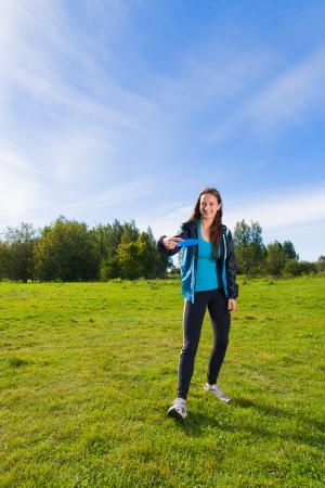 disc golf: Woman get ready to throw a disc, vertical format Stock Photo