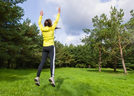 disc golf: Woman celebrating a score, disc went inside the basket