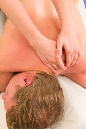 acupressure hands: A masseur is massaging a male customers shoulders in her surgery