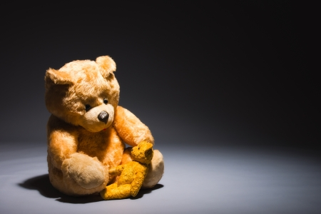 Teddy friends sits on a spotlight, horizon format