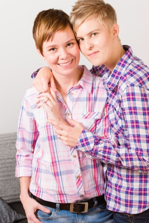 Posing happy lesbian couple have a good time together, vertical format Standard-Bild