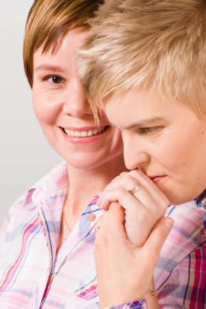 Lesbian kissing her girlfriend s hand, shared a moment, vertical close-up format photo