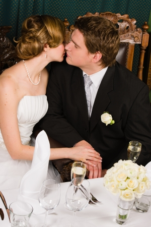 Romantic kiss bride and groom in wedding day photo