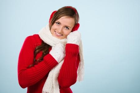 ear muffs: Beautiful young woman wearing a ear muffs and white scarf, horizon format Stock Photo