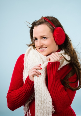 ear muffs: Beautiful young woman wearing a ear muffs and white scarf, vertical format