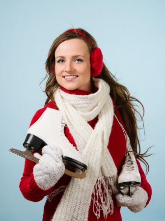 ear muffs: Beautiful skater wearing a ear muffs and white scarf, vertical format Stock Photo