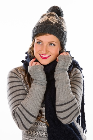 stocking cap: Beautiful young woman wearing wooly outfit, white background and vertical format