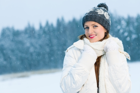 stocking cap: Winter, woman with warm outfit poses on outdoor, horizon format