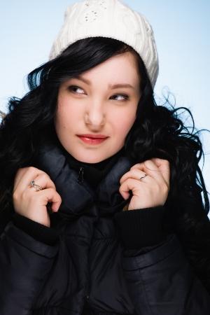 stocking cap: Beautiful girl wearing stocking cap, light blue background, vertical format