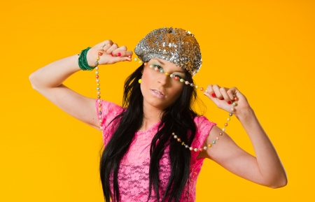 Beautiful expressing girl wearing colorful clothes, yellow background Stock Photo - 20236968