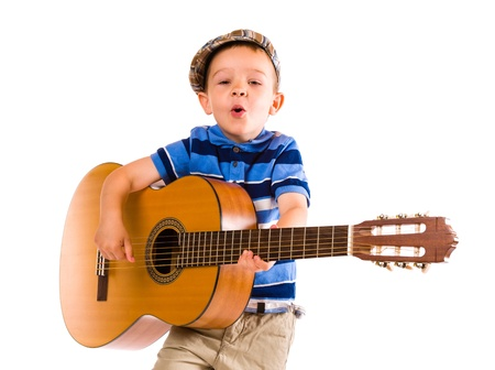 Child, 5 years old, plays guitar with emotion, white background