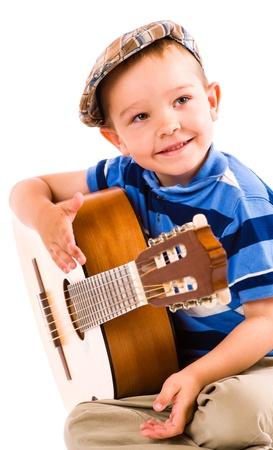 showman: El showman, muchacho de 5 a�os y la guitarra, fondo blanco Foto de archivo