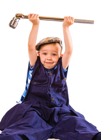 socket wrench: Little boy and heavy socket wrench, white background