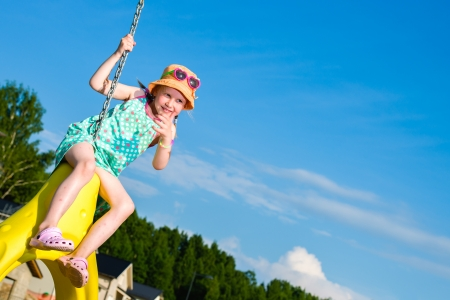 jungle gym: Young girl on the jungle gym, sunny day Stock Photo