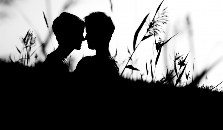 Lovely lesbian couple together on outdoor, silhouette, black and white image