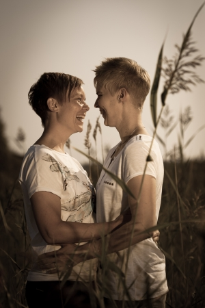 Lovely lesbian couple together on outdoor, sepia black and white image photo