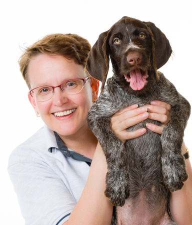 Happy woman and German wirehaired pointer puppy, 12 weeks old, white background Stock Photo - 22163405