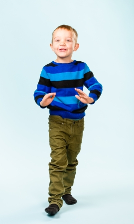 Playful little boy on studio, light blue background Stock Photo - 22442526