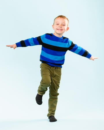 Playful little boy on studio, light blue background Stock Photo - 22442527