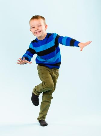 Playful little boy on studio, light blue background Stock Photo - 22442528