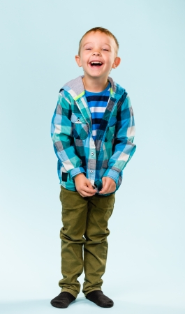 Playful little boy on studio, light blue background Stock Photo - 22442529