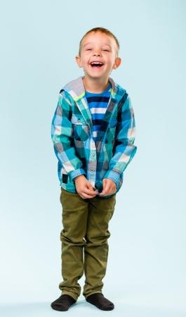 Playful little boy on studio, light blue background Stock Photo - 22442529