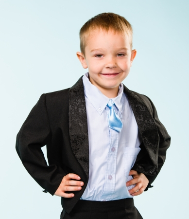 Handsome little boy posing on studio, light blue background Stock Photo - 22442569