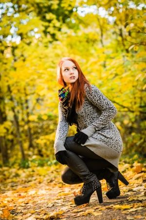 Girl with a high heels on the park, colors of autumn photo