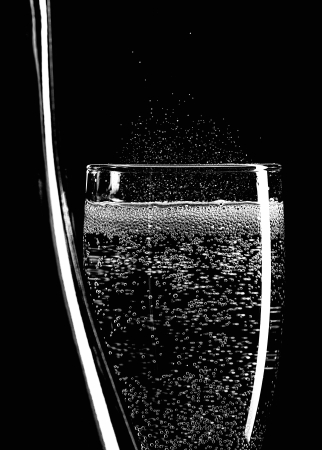 A champagne bottle and glass of sparkling wine, black and white image Stock Photo