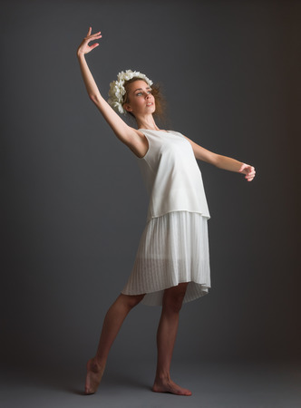 twiggy: Beautiful girl, ballet dancer wearing white dress, gray background