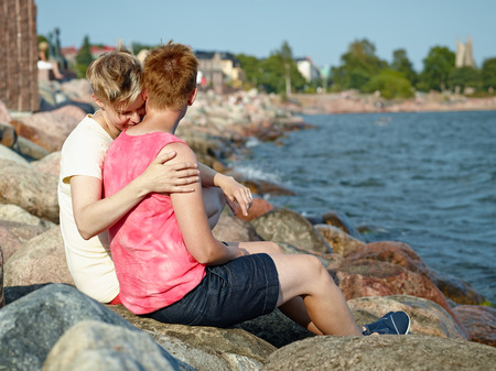 housemate: Women couple spend time together at the beach in the afternoon