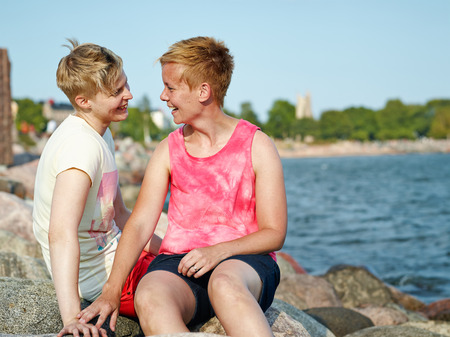 beautiful lesbian: Women couple spend time together at the beach in the afternoon