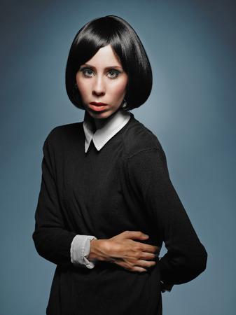 Beautiful young woman wearing pullover and shirt - studio shot photo