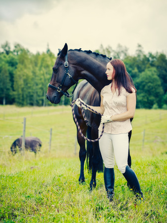 horse collar: Attractive woman and horse in the field, cross processed image