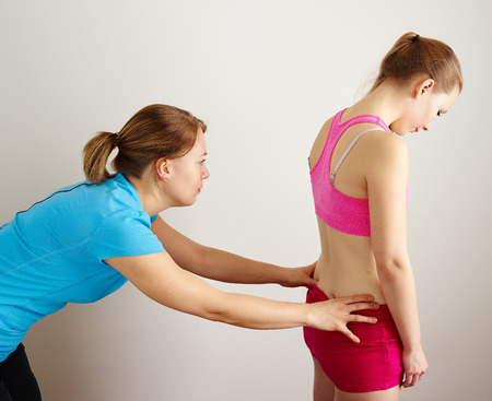 Osteopathy treatment, the professional masseuse and her patient Standard-Bild