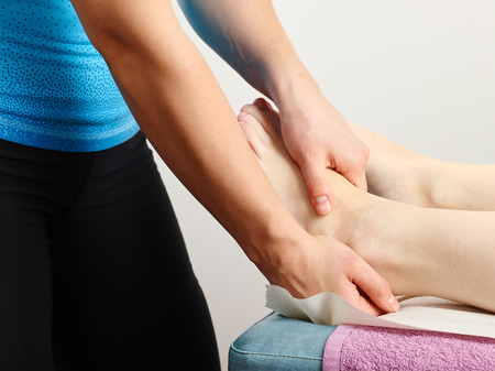 Osteopathy treatment, the professional masseur and his patient photo
