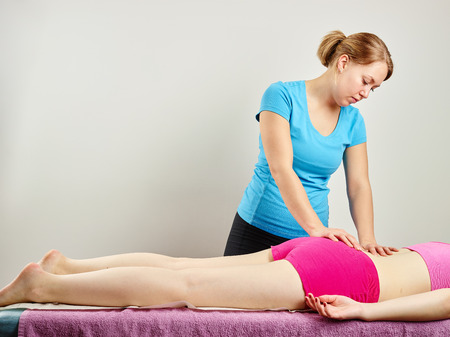 osteopathy: Osteopathy treatment, the professional masseuse and her patient Stock Photo