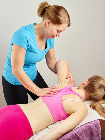 Osteopathy treatment, the professional masseuse and her patient Stock Photo
