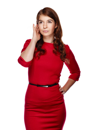 Attractive young adult woman wearing red dress and she looking away - white background