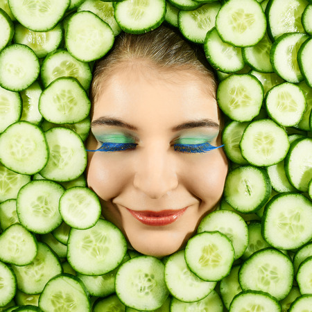 countenance: Beautiful woman expression face with cucumber slice frame