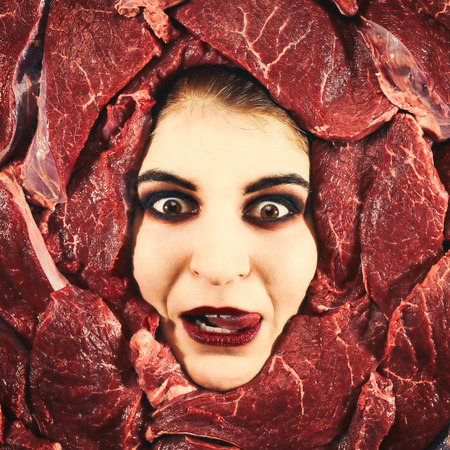 countenance: Beautiful woman expression face with beef frame, cross-processed image